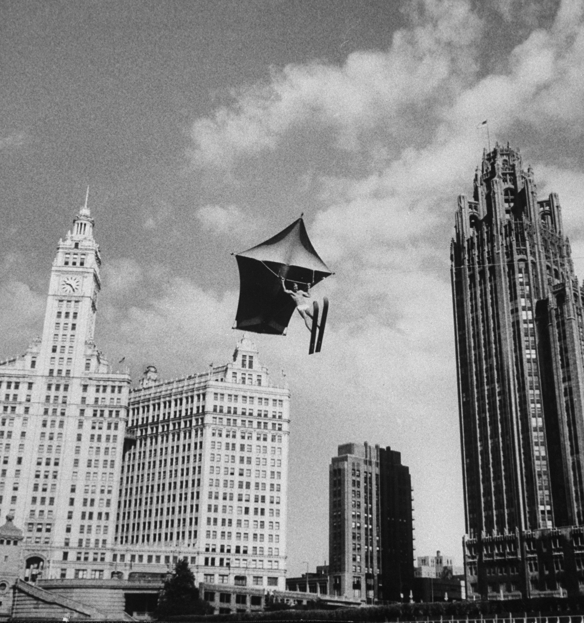 Stunt man Jack Wylie soars over the Chicago River, 1958.
