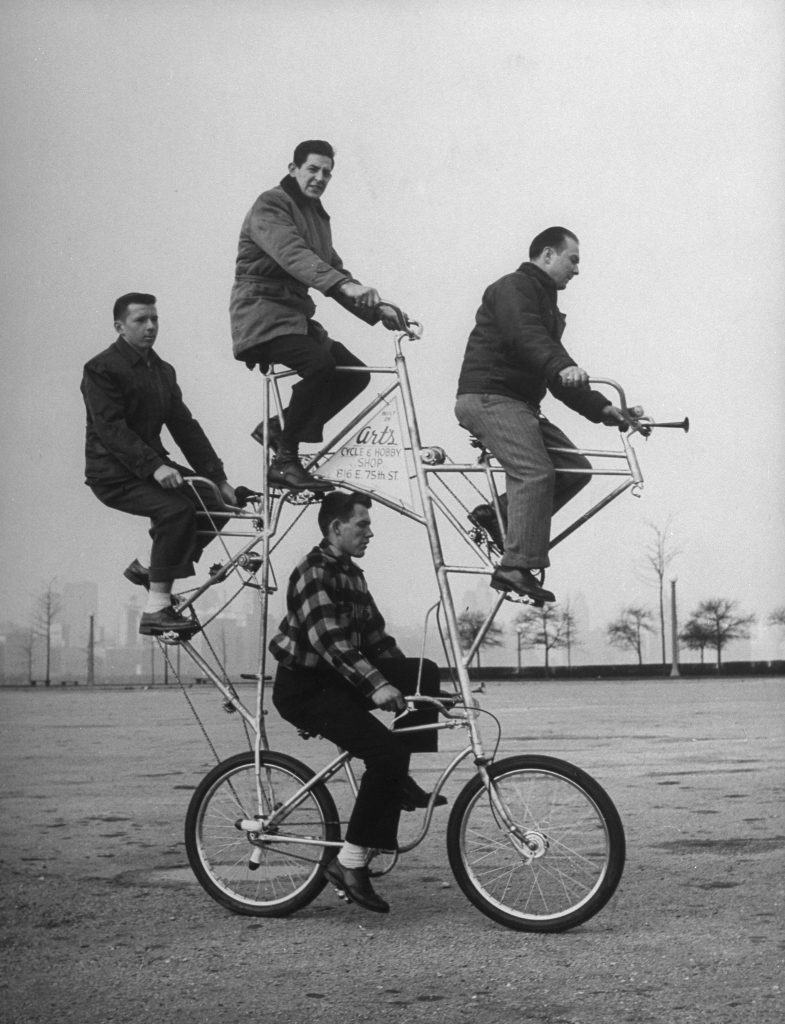 Eccentric four-man bicycle built by Art Rothchild (top position).