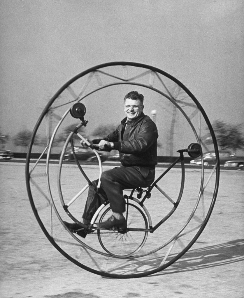 Uno-wheel bicycle, if braked suddenly, can send its rider round and round inside the big main wheel, designed by member of the Nat'l Bicycle Dealers' Assoc.