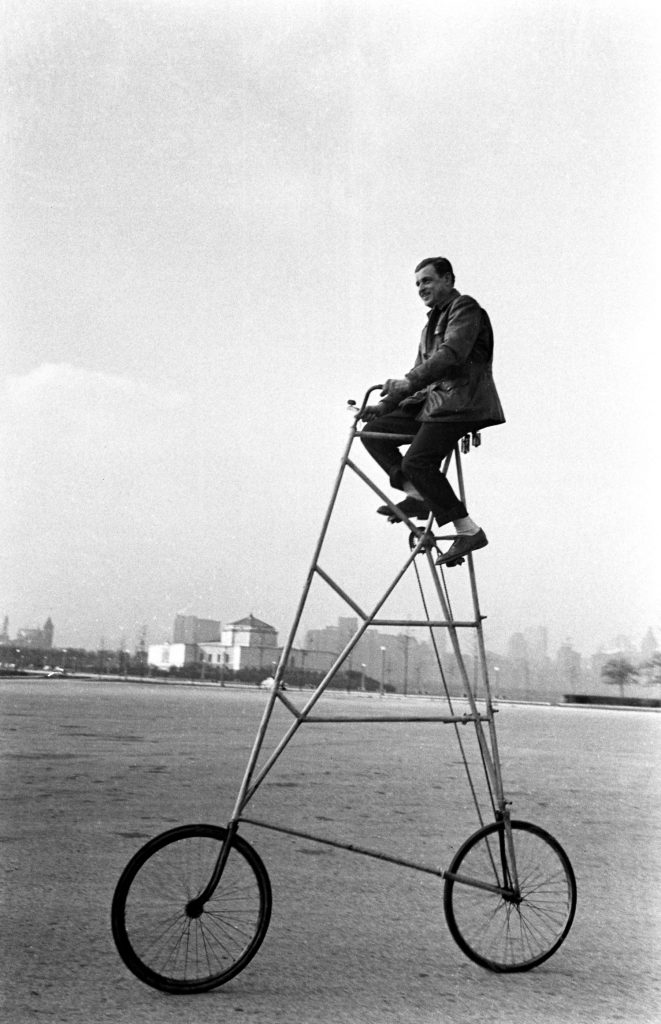 Riding a preposterous bicycle, Chicago, 1948.