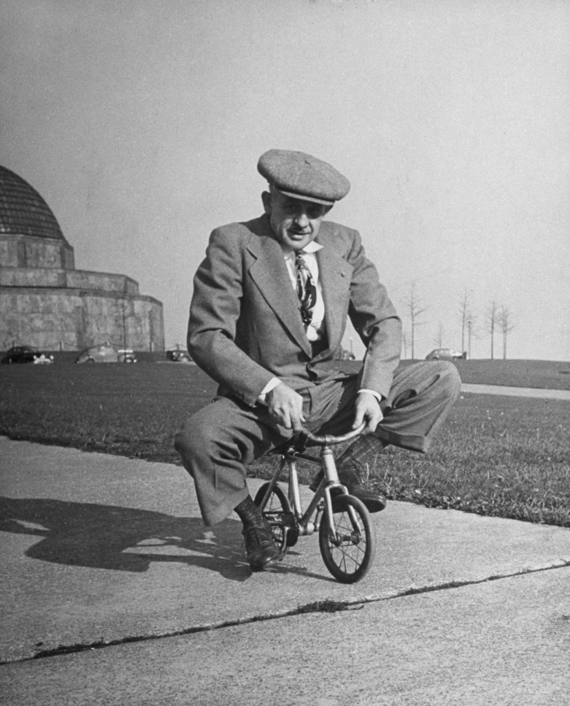 """Chicago bicycle dealer Andy Koslow rides a tiny bike built by a former vaudevillian. """"This helps limber up his left leg,"""" LIFE wrote, """"which, as a former motorcycle racer, he broke seven times."""""""