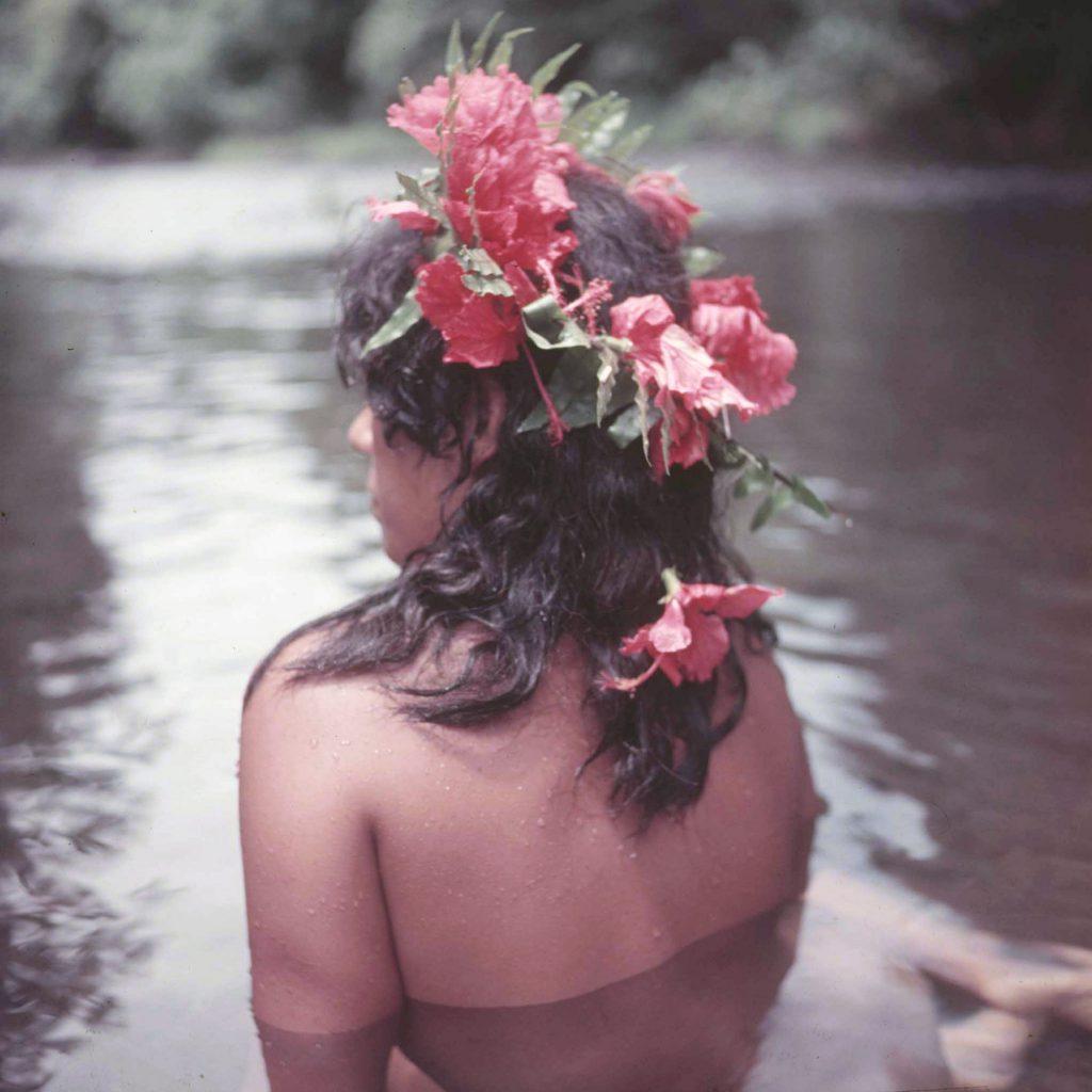 Tahitian girl bathing.