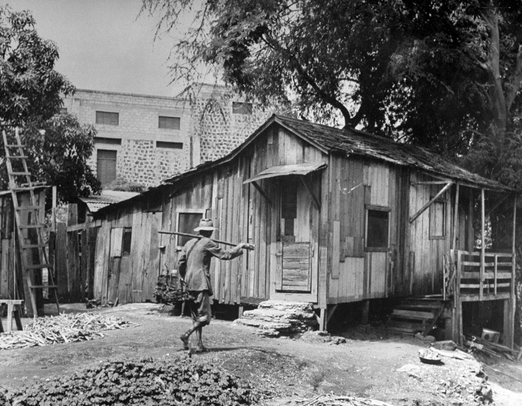 Old Japanese man walking toward his house.