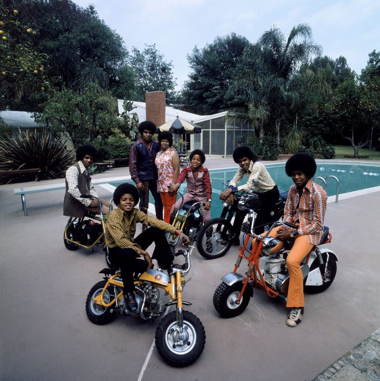 Members of pop group Jackson Five (clockwise L-R): Jackie, parents Joe and Katherine, Marlon, Tito, Jermaine and Michael in their backyard.