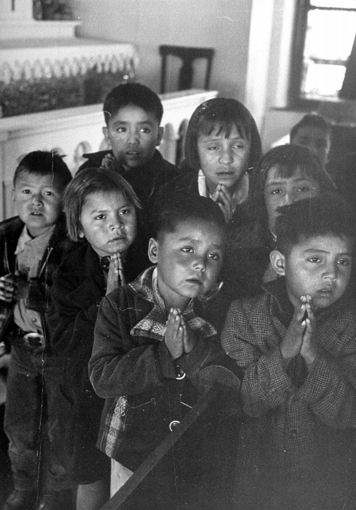 Navajo children receiving religious instructions.