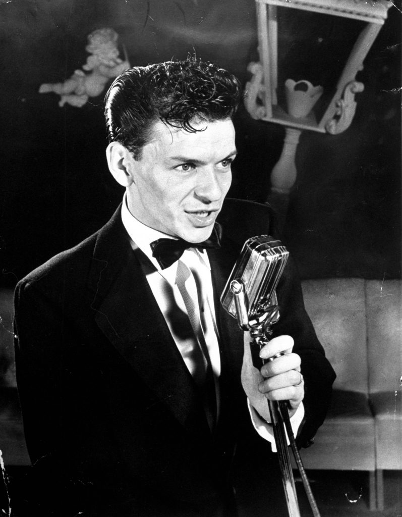 25 year old Frank Sinatra poised at mike, singing As Time Goes By at Riobamba nightclub, 1943.