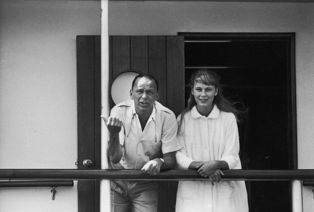 Frank Sinatra with girlfriend Mia Farrow on deck of yacht Southern Breeze, 1965.