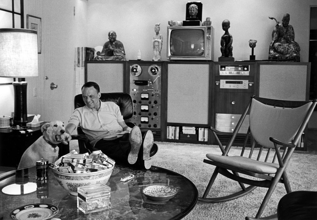 Frank Sinatra relaxing with pet dog Ringo at home, 1965.