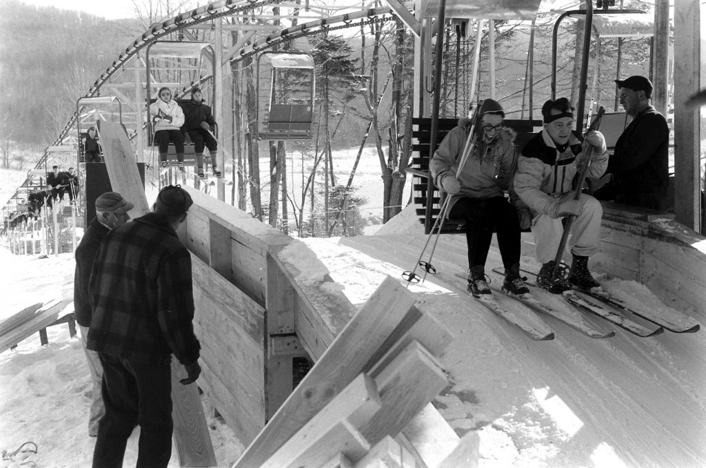 Double-chair life at Mt. Snow gives novices a luxury usually enjoyed only by crack skiers. Rushed carpenters finish their work after it goes into use.