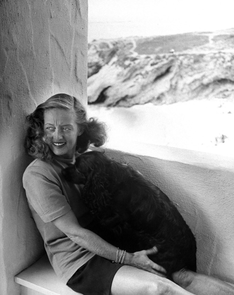 Bette Davis with her dog in California, 1947.