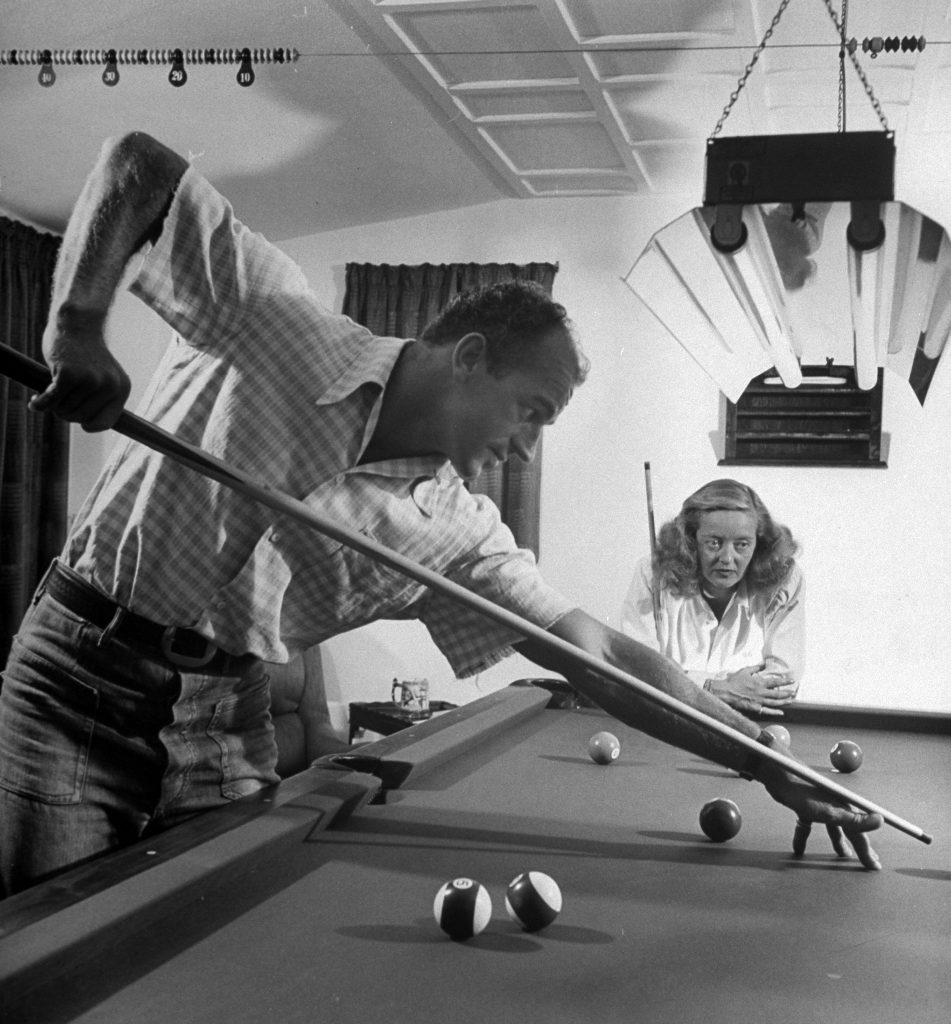 Bette Davis and her third husband, William Grant Sherry, playing billiards at home in California, 1947.