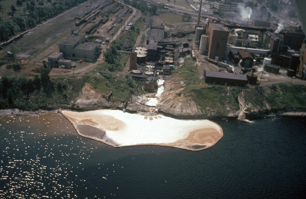Color photos of pollution in the Great Lakes in 1968.