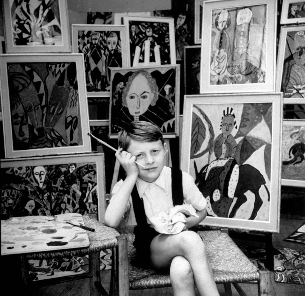 Nine year old prodigy, Hansan Kaptan, Turkish child, has an exhibition at a gallery in Paris, France, 1951.