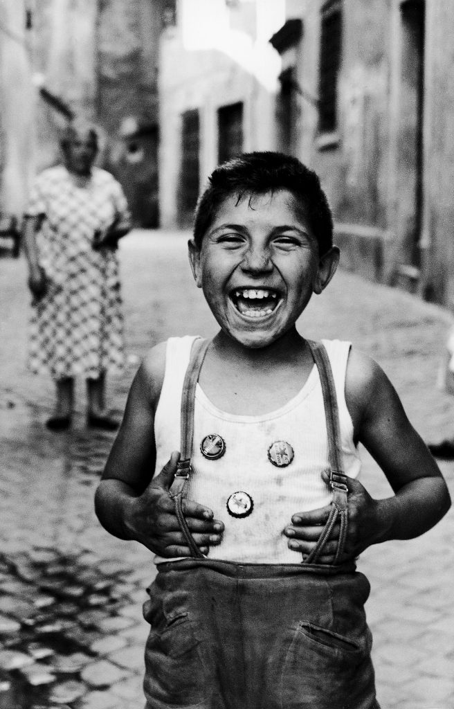 Laughing boy on street in Trastevere, Rome, 1958.
