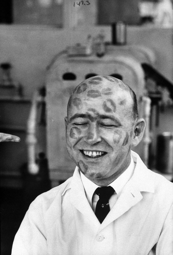 Richard Ramsey, worker in cosmetic company covered with relics of iipstick kisses to prove that dyes in lipsticks are harmless. 1960.
