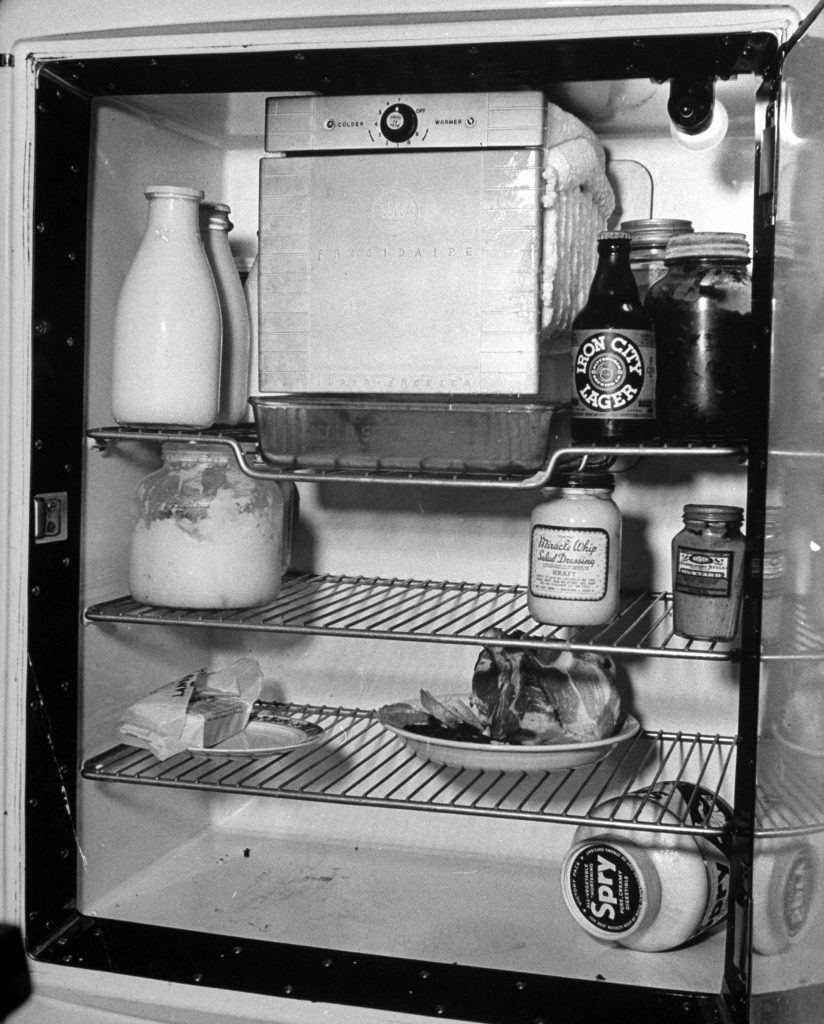 An open refrigerator showing the contents in a steel workers home in Pittsburgh.