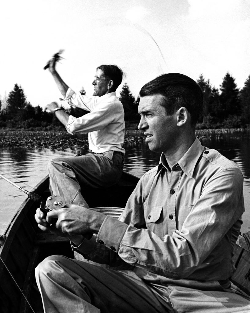 "Jimmy Stewart (R) bass fishing with his friend Clyde ""Woodie"" Woodward, upon his return from WWII, 1945."