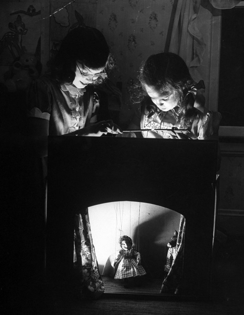 """Suzy Creech and friend, typical 10 year-old girls known as """"pigtailers"""" playing """"Red Riding Hood,"""" 1946."""