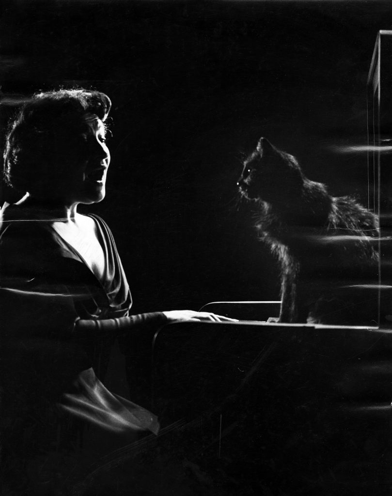 Russian-born American operatic mezzo-soprano Jennie Tourel sings as a cat named Blackie sits on a piano, 1952.