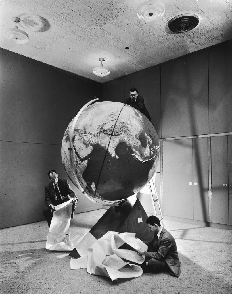 Smithsonian Institution scientists Dr. Josef A. Hynek, Fred L. Whipple and Don Lautman plotting orbit of Sputnik I.