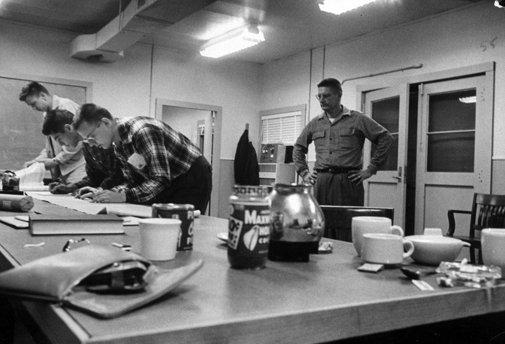 Analyzing data picked up, scientists at Minitrack station near Washington let coffee get cold.
