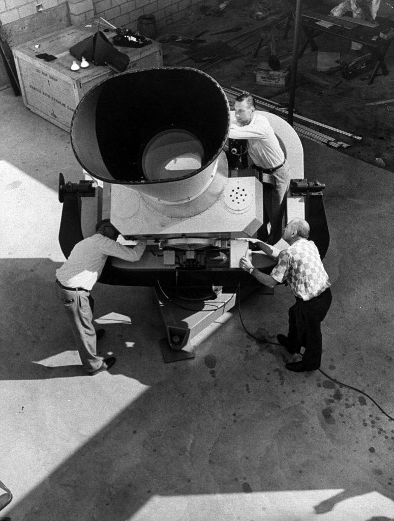Huge camera, one of 12 built to track U.S. Vanguard, is assembled in California to track Sputnik.