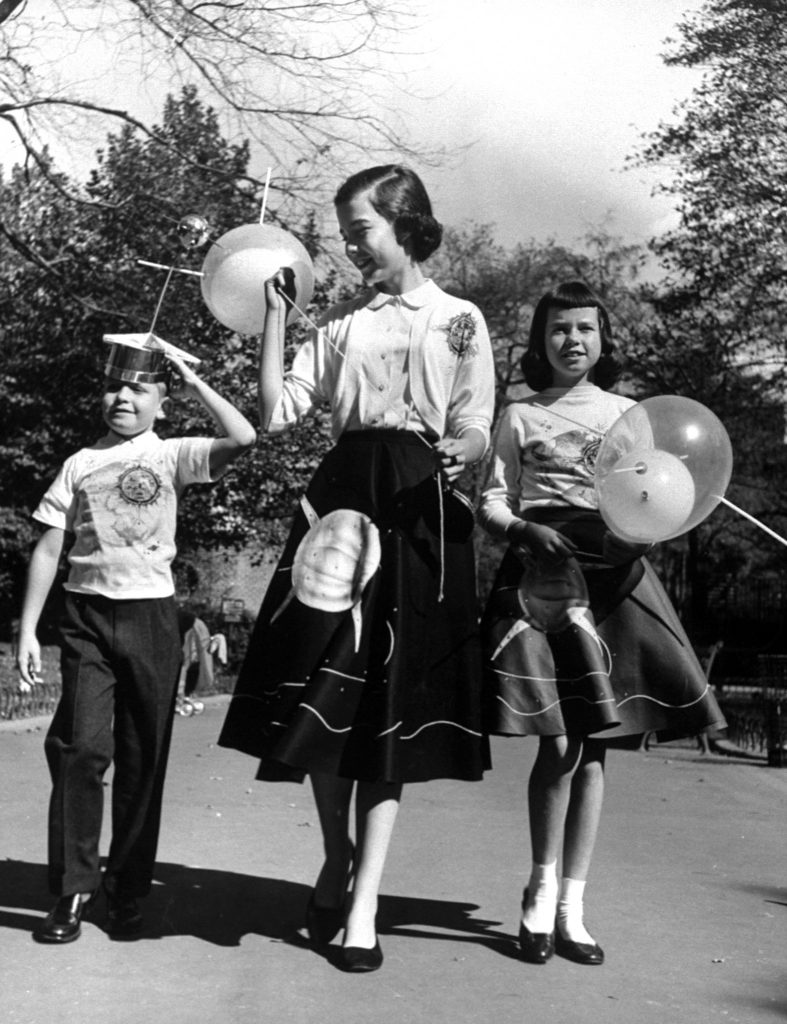 Space fashions rushed onto market include skirts, jackets, hats, balloons with satellite motif.