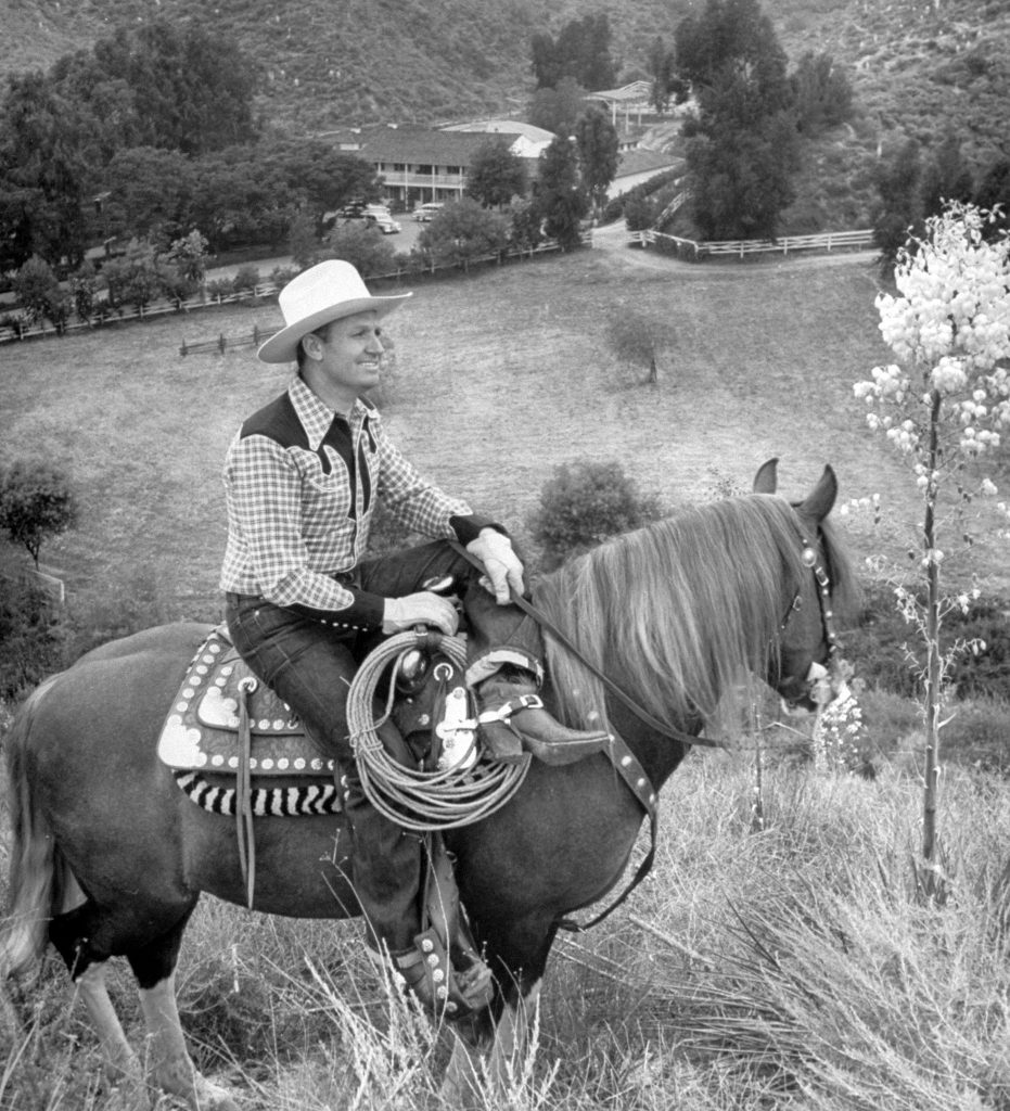 Gene Autry astride his horse Champion surveying his Ranch, 1948.