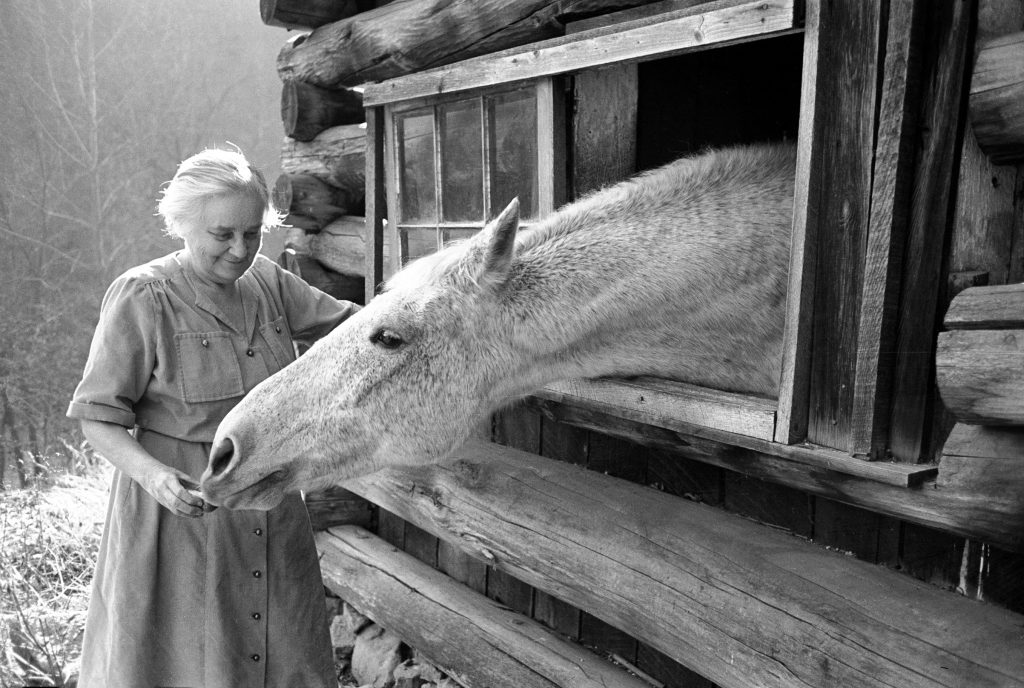 Mrs. Mary Breckenridge who runs Frontier Nursing Service, petting her horse. Leslie Country, Kentucky, 1949.